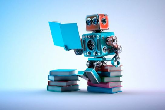 small-robot-sitting-on-pile-of-books-and-reading.jpg